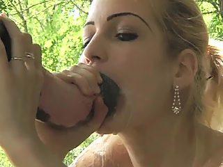 Gorgeous babe sucking stallion dick